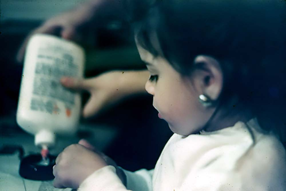Nina with glue at age three